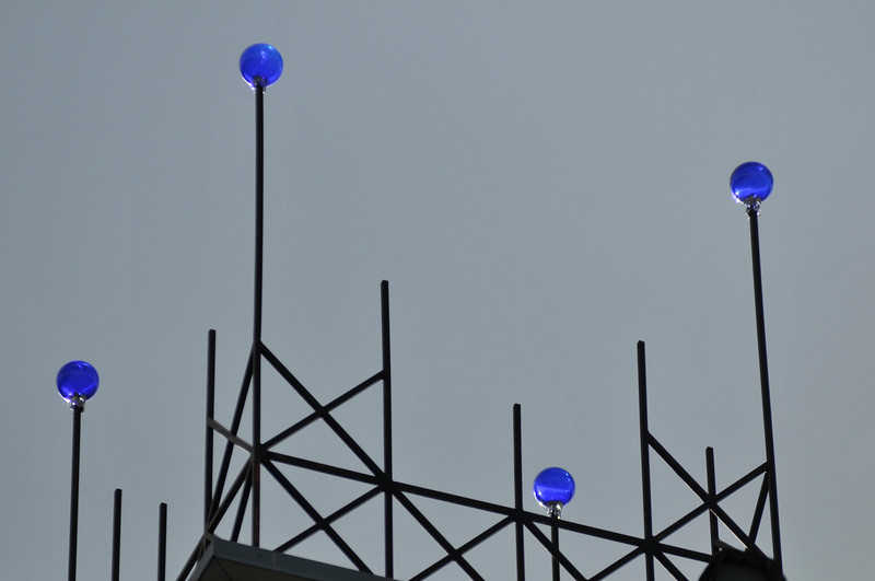 Walt Hester | Trail Gazette<br /> Blue glass balls catch late afternoon light from the top of Mama Rose's on Thursday.