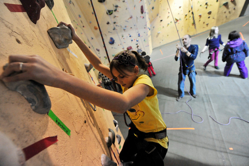 Walt Hester | Trail-Gazette<br /> Chloe Jensen scales the indoor climbing wall at the Estes Park Mountain Shop on Wednesday. The shop offers climbing classes to give Estes Park school children something health and constructive to do after school.