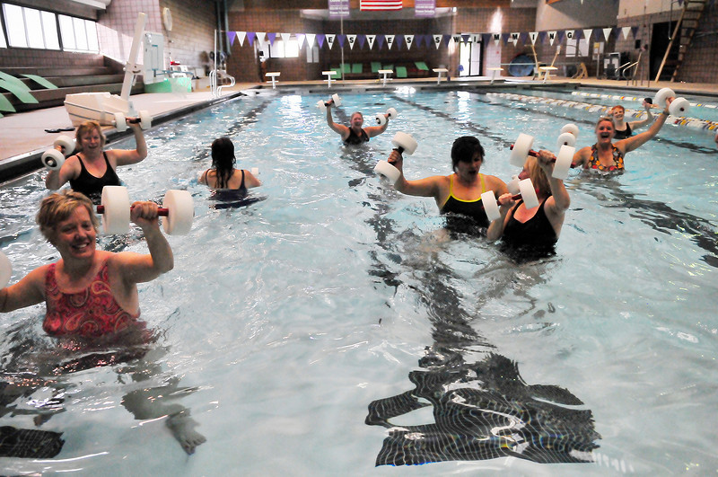 Walt Hester | Trail-Gazette<br /> Ladies splash and pump in the pool at the Estes Park Aquatic Center on Tuesday. The shallow water aerobics class helps participants get their heart rates up while being gental to joints.