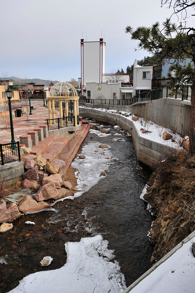 Walt Hester | Trail-Gazette<br /> Snow and ice collect on the Fall River as it snakes through downtown Estes Park on Tuesday.