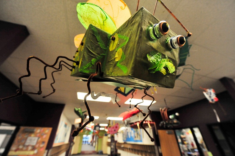 Walt Hester | Trail-Gazette<br /> Bugs created by the Estes Park Elementary School hang from the school's ceiling on Wednesday. The school's second-graders annually study insects and make their own to demonstrate what they've learned.