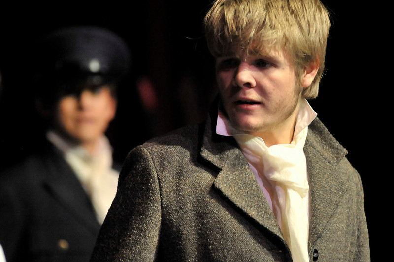 Walt Hester | Trail-Gazette<br /> Joey Sisk portrays the hero, Valjean, the parolee struggling for redemption while constently pursued by policeman Javert, played by Sean McAlpin.
