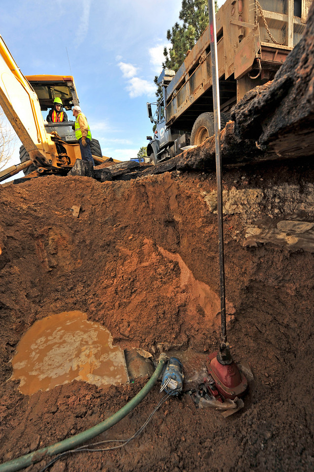 Walt Hester | Trail-Gazette<br /> Bob Leadley, in backhoe, and Phil Rau discuss the broken valve below Stanley Circle on Wednesday. The town Public Works Department has to drain the 6-inch pipe before replacing the broken valve.