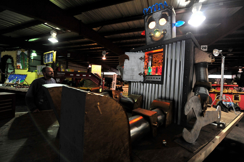 Walt Hester | Trail-Gazette<br /> Michael Young shows off a new creation for the annual parade, Yule the robot, as he puts the final touches on the floats.