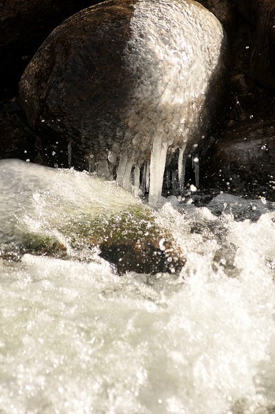 Walt Hester | Trail Gazette<br /> Turbulent water on the Big Thompson River forms ice on rocks along the shore on Thursday. Temperatures should increase toward the end of the week in Estes Park.