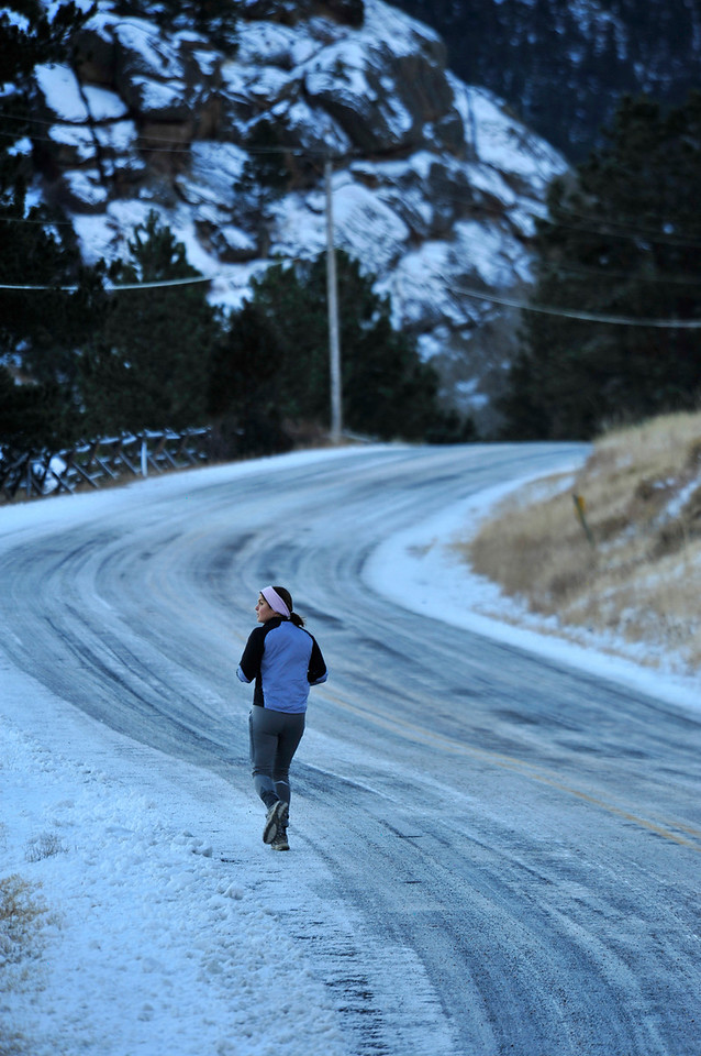 Walt Hester | Trail-Gazette<br /> Arren Allegretti of Fort Collins admires the new snow-covered landscape along MacGregor Avenue on Wednesday. Estes Park may see temperatures in the 50s by weeks end.