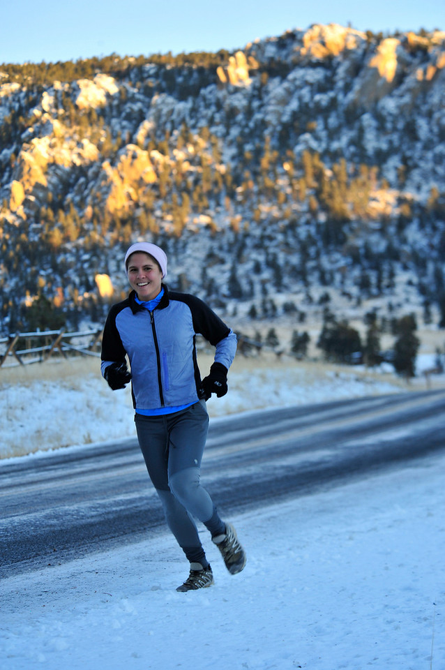 Walt Hester | Trail-Gazette<br /> Arren Allegretti of Fort Collins carefully jogs along MacGregor Avenue early on Wednesday morning. Winter weather can make outdoor training treacherous, extra clothing and attention to road and trail conditions is a must.