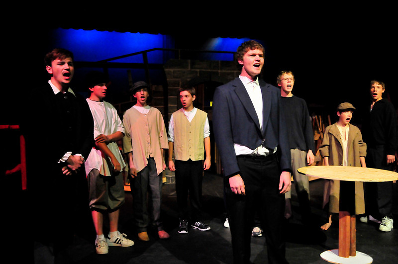 Walt Hester | Trail-Gazette<br /> Student revolutionaries, lead by Marius, played by Hunter Sutterfield, far left, and Enjolras, played by Dylan Westover, center. Marius falls in love with Cosette, while Enjolras and his followers are destined to die in the Paris uprising of 1832.