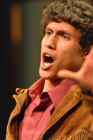 Sean McAlpin portrays mountain man Adam Pontipee in the Estes Park High School production of Seven Brides for Seven Brothers. The musical depicts the frontier life of Pontipee's brothers' efforts to find wives, and the havoc it causes both in the little frontier town and their own little mountain cabin.