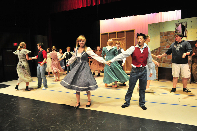 The cast of Seven Brides for Seven Brothers runs through a dance number at the high school auditorium on Monday. The Estes Park Hig School's production will run Friday, November 16, and Saturday November 17 at 7 p.m.
