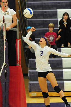 26EPVB Kingswood Hits.jpg Senior Karin Kingswood punches at a ball last week. The durable Kingswood played all 61 matches for the Ladycats.