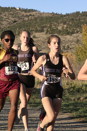 26EPXC Kelsi and Holli.jpg Kelsi Lasota (155) and Holli Holmes (154) run along side a Brush runner at the Northern Colorado Regional cross country meet on Friday. Lasota took more hardware home, winning the regional championship, while Holmes finished 9th, helping the girls' team place second at the meet.