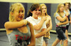 sena krula cheerleader.jpg 22EPCheer Smiling.jpg Walt Hester | Trail-Gazette<br /> Sena Krula, 16, smiles while learning a new routine during practice on Monday. Krula will captain the team this year.