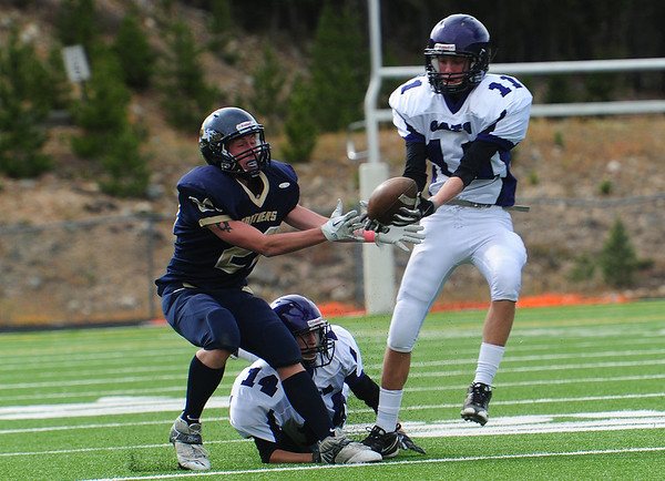 24EPFB INT.jpg Estes Park defensive back Isaak Cirone takes an interception off of the fingertips of Nederland receiver Dillon Weaver in the second quarter of the Bobcats' game on Saturday. The Bobcats snatched four interceptions against the Panthers.