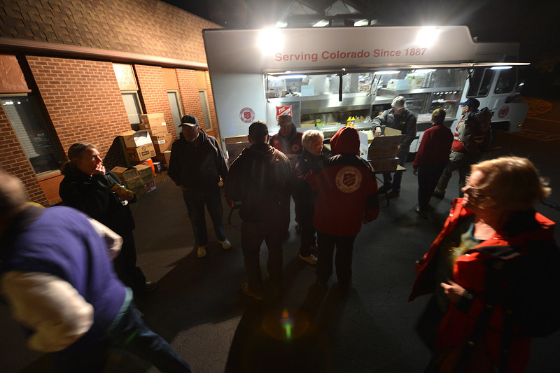 Volunteers and evacuees prepare for dinner at the Salvation Army canteen on Sunday. The canteen provides meals for those displaced by the fire.
