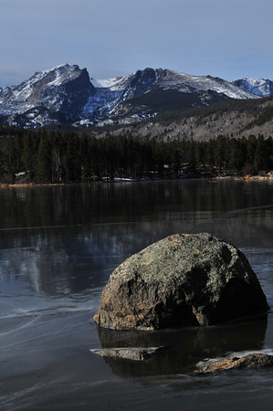 The high peaks of the national park reflect off of the frozen surface of Sprague Lake on Wednesday. While the days are colder, Rocky Mountain National Park is still beautiful.