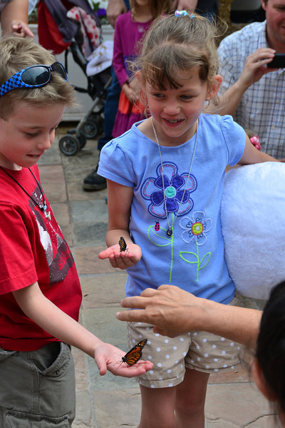 A couple of young guests at the Stanley Hotel enjoy their experience during the June 10 weekly butterfly release.