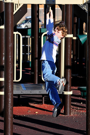 Walt Hester | Trail-Gazette<br /> Sawyer Basch, 6, enjoys some after-school fun at the elementary school play ground on Wednesday. The sun will be down earlier next week with the end of Daylight Savings Time early Sunday morning.