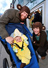 Walt Hester | Trail-Gazette<br /> Adam and Elizabeth Paashaus showoff their top banana, Sadie, 4, along Elkhorn Avenue on Sunday. The downtown trick or treating was the family portion of the weekend.
