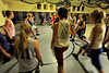 Walt Hester | Trail-Gazette<br /> Brian Holmes gets the Ladecats cagers warmed up on Wednesday. The warm up was helping the girls develope muscular endurence, as well as preparing them for court time.