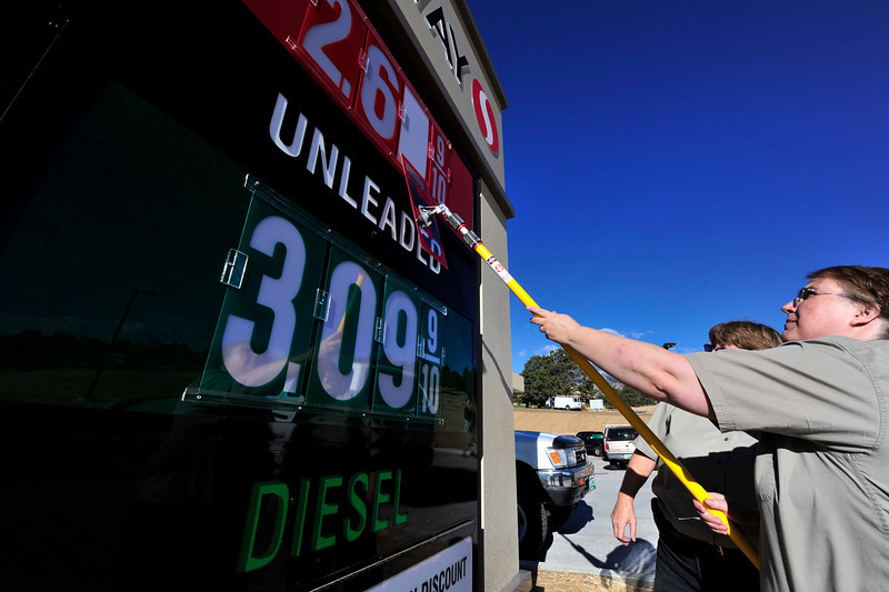 Walt Hester | Trail-Gazette<br /> Kristen Zumdone posts the gas prices at the new Safeway filling station on Big Thompson Avenue on Wednesday. The station officially opened on Wednesday morning.
