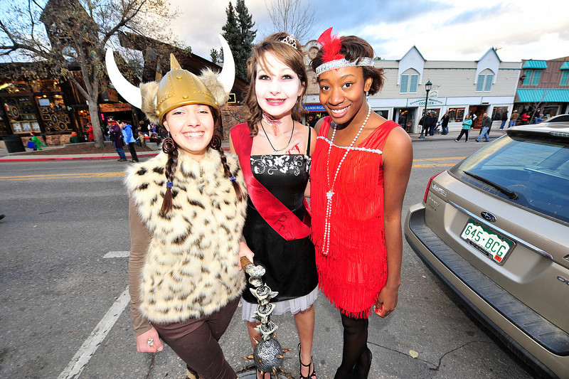 Walt Hester | Trail-Gazette<br /> Friends Lauren Mollé, 17, Claire Mollé, 16, and Nia Smith, 16, enjoy the evening out together on Halloween Sunday.