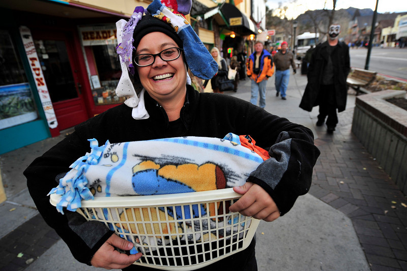 Walt Hester | Trail-Gazette<br /> Lonnie Erskine is a basket of laundry on Sunday during the annual Halloween celebration on Elkhorn Avenue.