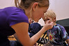 Walt Hester | Trail-Gazette<br /> Izzia Smith, 13, applys face paint to Odin Rhode, 4, at the annual Book Fair Carnival at the Estes Park Elementary School on Thursday evening.