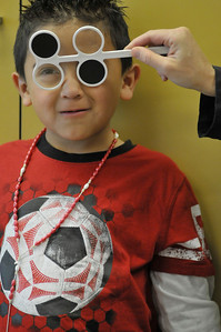 Photo by Walt Hester Kindergarten student Franco Rangel Hernandez reads a chart at the EStes Park Elementary School on Tuesday. The school performed it's annual vision and hearing check this week.