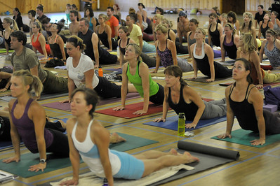 Photo by Walt Hester A class performs a classic pose within yoga. Like many martial arts, yoga consists of a series of poses, from the very basic to the extremely challenging, strong togther in different combinations.