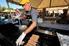 Photo by Walt Hester<br /> David White grills brats at the Sunrise Rotary Club's Autumn Gold festival in Bond Park on Sunday. The annual event lures visitors to Estes Park to enjoy beer, brats and bands, as well as the fall colors in and around town.