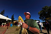 Photo by Walt Hester<br /> Christi Filey of Lakewood, Colo. carries ears of corn around Bond Park during the annual Autumn Gold Festival on Sunday. While beer and brats were the featured fare, other autumnal treats were available.