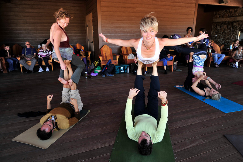 Photo by Walt Hester<br /> Yoga practitioners arch, balance and twist during a session of Acro-Yoga at the conference on Saturday. The practice emfaci