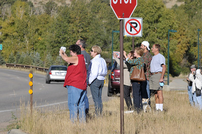 Photo by Walt Hester Visitors line up at the south CVB parking lot to photograph a small herd of elk across the road on Sunday morning. RVs stopped along the road, visitors walked into the road and traffic was slowed though not entirely stopped.