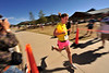 Photo by Walt Hester<br /> Abra McGillivary of Fort Collins cruises across the finish line at the Running of the Bulls at the Lake Estes Marin on Saturday. The race was a fund raiser for Partners Mentoring of Estes Park.