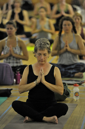 Photo by Walt Hester<br /> A class gears up with centering and relaxing meditation on Saturday.
