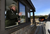 Walt Hester | Trail Gazette<br /> Mark Nydell welcomes visiters to Rocky Mountain National Park on Saturday. The national park was still open after Congress and President Obama reached a budget deal that kept the federal government from shutting down.