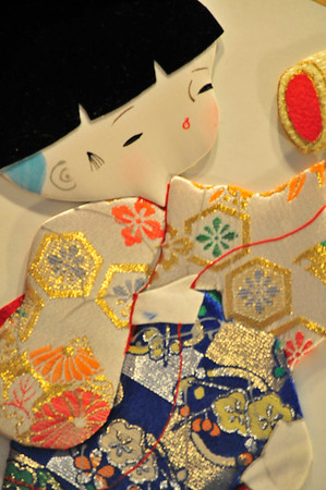 Walt Hester | Trail Gazette<br /> A little fabric and paper doll represents a Pacific Asian holiday. Each case showed customs and cultures, including holidays that  children may not know of.