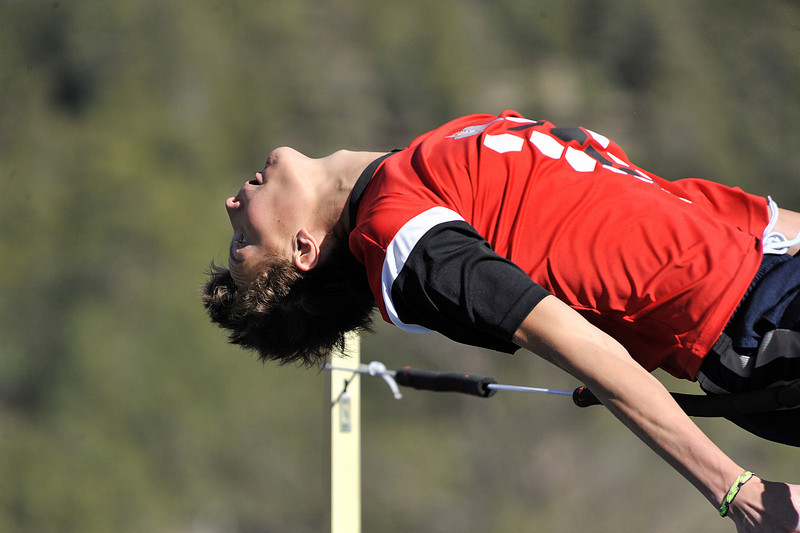Walt Hester   Trail Gazette<br /> Estes Park's Avi Weissman tries to arch over a line during track practice at the high school on Monday. The Estes Park jumpers, as well as runners, are enjoying a successful track and field season, so far.