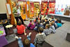 "Walt Hester | Trail Gazette<br /> Kerry Aiken of the Estes Valley Public Library explains the displays to fifth-graders at the Estes Park Elementary School on Monday. ach case is 6'4"" tall and 6' wide and full of items representing the many cultures and ethnicities that can be found in the world."