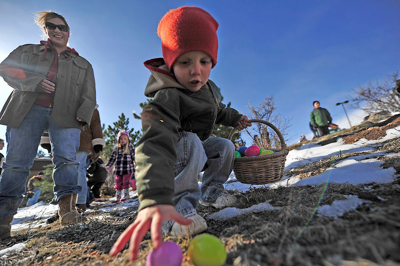 Walt Hester | Trail Gazette<br /> Thompson Shuttleworth, 3 reaches for the colorful treasure during the 0-3 age group's egg hunt. The challenge of thesearchis also scaled to the age groups for the egg hunts.