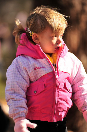 Walt Hester | Trail Gazette<br /> A younger collector wearing spring colors on her winter coat watches the next wave of children begin their egg hunt. While warmer thanprevious days, Saturday morning was still chilly, with plenty of left-over snow to tromp through.