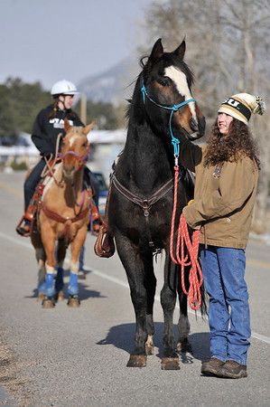 Walt Hester | Trail Gazette<br /> Alyssa Bartush, right, and Cassie Fisher start Saturday strolling with their large, four-legged friends Kachina and Baby, respectively. Though chilly and windy, the Rooftop Rodeo Queen, Fisher, and princess, Bartush, had a little sunshine on their side.