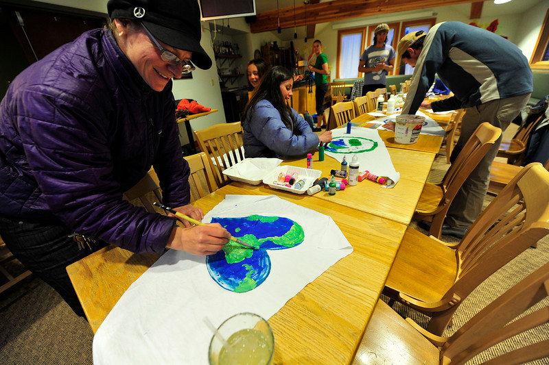 Walt Hester | Trail Gazette<br /> Kelly Cramer of Progressive Estes paints a flag Wednesday night, destined for her bicycle. Progressive Estes plans a Critical Mass community bicyle ride on Friday to celebrate Earth Day.