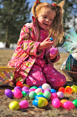 Walt Hester | Trail Gazette<br /> Laurel Williamson removes a chocolate egg from inside the plastic shell on Satruday. While most of the eggs contained Easter candy, some contained a ticket for a larger basket of goodies.