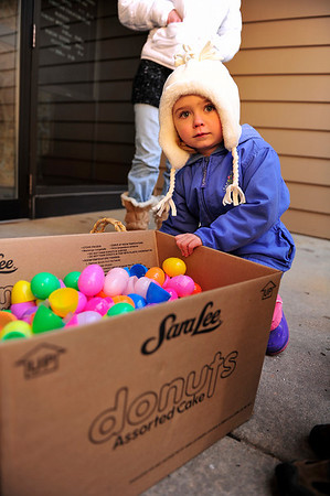 Walt Hester | Trail Gazette<br /> Lily Schiller, 4, helps recycle her colorful Easter egg shells after removing the contents on Saturday. The Quota Club encouraged participants to return the shells so they may use them again next year.