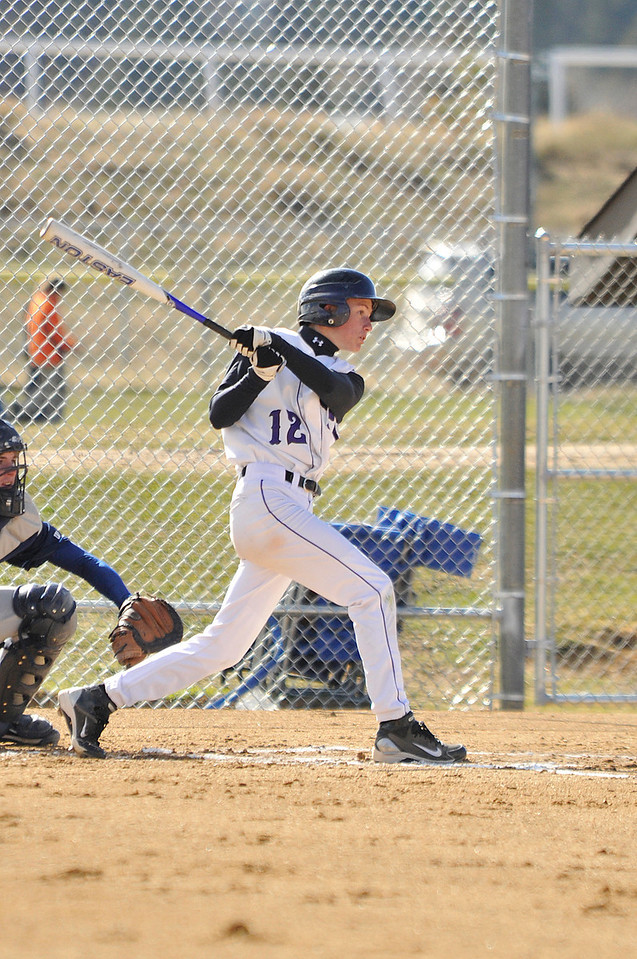 Walt Hester | Trail Gazette<br /> Austin Gallitin connects against Platte Valley on Thursday. The Bobcats peppered the visiting Broncos for 14 runs in the home victory.