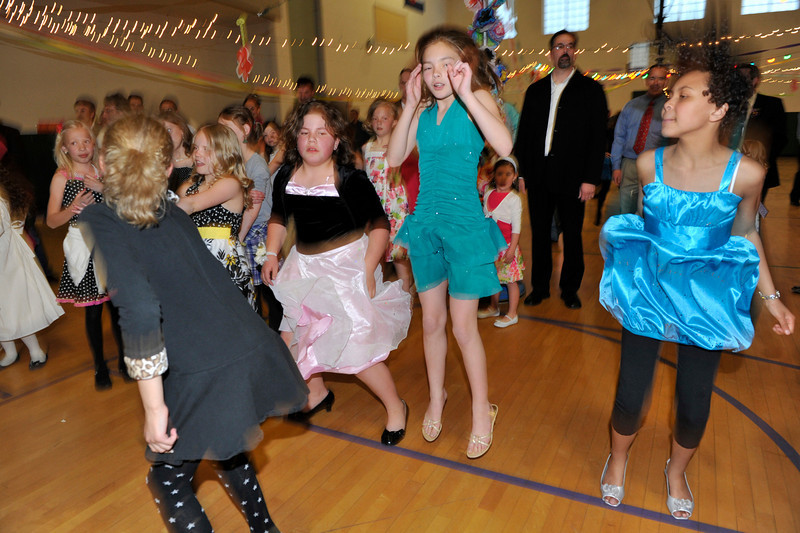 Walt Hester | Trail Gazette<br /> Fathers, daughters and a few moms do the Macarena at last Friday's third annual PTO Father-Daughter dance. More than 200 tickets were sold to the event that invited brothers and moms to join in the fun.