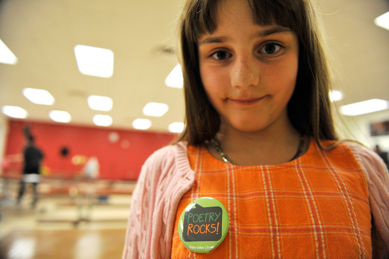 Walt Hester | Trail Gazette<br /> Lexu Schrat, 9, shows her feelings with a button at the annual Poetry Cafe at the Estes Park Elementary School on Thursday. The event, sponsored by the Estes Valley Public Library is part of a celebration of Poetry Month.