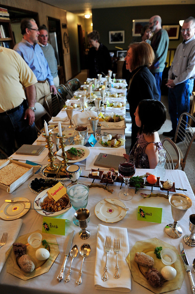 Walt Hester   Trail Gazette<br /> Friends and family gather around a Sedar dinner table on Monday. Monday was the first night of the Jewish holiday of Passover, recalling the night inwhich the Angel of Death passed over the houses of Israel while smoting the first-born children of Egypt, as told in the Biblical book of Exodus.